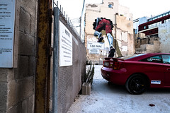 escaping (Andrea Scire') Tags: juxtaposition italian escaping graffiti wall color fujifilm xpro2 14mm red street streetphotography fotostreetit