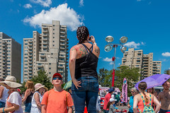 Standing On the Seawall (Facundity) Tags: streetphotography tattoo mother building bluesky streetcandid braid jeans back hats festival streetfestival canoneos70d peoplewatching boy architecture summer