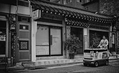 The carriage of the Destiny (Joey Gonin) Tags: blackandwhite urban city southkorea seoul people street streetphotography streetlife kart chariot woman asia travel strange backpack roadtrip