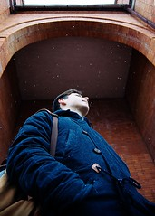 Kirill #2 (anastasia_smirnova) Tags: urban city street architecture photography russian russia man young white cold snow day winter sky vertical standing up outdoor outdoors bricks coat breathe building red blue travel model rodchenko posing