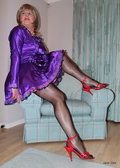 9 Time for a rest (janegeetgirl2) Tags: transvestite crossdresser crossdressing tgirl tv ts stockings heels garters nylons glamour petticoat purple red satin dress stilettos fully fashioned high vintage seams maid black suspenders jane gee