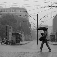 Regen in Berlin (duqueıros) Tags: street city bw woman berlin rain umbrella germany square deutschland blackwhite strasse stadt barefoot sw frau schwarzweiss regen regenschirm barfuss duqueiros