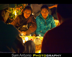 Day of the Dead in Xoxocotlan Cemetery, Oaxaca, Mexico 2012 (Sam Antonio Photography) Tags: november portrait people latinamerica cemetery grave horizontal night dayofthedead mexico outdoors death lowlight memorial day candle ambientlight memories decoration naturallight visit illuminated altar spirits celebration oaxaca relative marigold gravesite highiso electriclight oaxacacity travelphotography mexicovacation deadrelatives mexicanculture mexicantraditions mexicantradition mexicangirls mexicanmen mexicanwomen mexicancelebration fullframecamera dayofthedeadoaxaca eldiadelmuertos samantonio celebratingthedead traditionalculturenight dayofthedead2012 copyrightsamantoniocom waistupmexicotraditionalcultureflower holidayartscultureandentertainmentdead photographingthedayofthedead canon5dmarkiireview