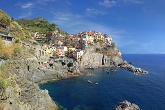 The best classical view on Manarola (Bn) Tags: world ocean park pink blue trees houses sea vacation sky orange sunlight flower tower heritage church water colors beautiful weather saint swimming buildings polaroid coast topf50 warm mediterranean italia sailing ship torre gulf hole hiking path five character liguria hike case cliffs quay historic bougainvillea unesco via vineyards national wharf terre sail ravine mountainside overlooking quaint inspire incredible viewpoint picturesque coloured topf100 manarola cinque giovanni italians italianriviera torri confraternita battista dellamore 100faves 50faves visipix guardiolas