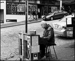 Pike Place Piano Man. (Trevor Ducken) Tags: seattle november people blackandwhite bw man film mediumformat person washington pentax kodak trix piano streetphotography wa pikeplacemarket 6x7 2012 pentax6x7