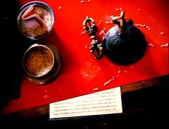 Passing by the monk's desk at break, dorje and bell, prayers in Tibetan, offering rice, cash, Sakya Lamdre, Tharlam Monastery of Tibetan Buddhism, Boudha, Kathmandu, Nepal (Wonderlane) Tags: nepal lamdre tibetan buddhist buddhism religious spiritual esoteric tantra sakya 7984 passingbythemonksdesk prayersintibetan offeringrice cash tharlammonasteryoftibetanbuddhism boudha kathmandu passing by monks desk dorje bell dorjeandbell sakyalamdre break wood blur