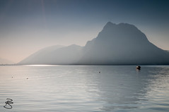 Lago di Lugano at Sunset (medXtreme) Tags: sunset sun mist mountain mountains alps reflection berg boot schweiz switzerland boat reflex ticino haze wasser sonnenuntergang lakes berge alpen seen sonne spiegelung lugano gebirge cokinfilter dunst mountainrange schleier schwaden haziness lagodilugano castagnola gewsser massiv lichtreflex mistiness luganersee lagoceresio inlandwater binnengewsser gebirgszug widerschein stretchofwater lidosandomenico diesigkeit kantontessinti montesansalvatore912m