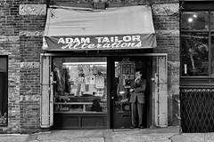 Adam Tailoring & Alterations (John Westrock) Tags: seattle blackandwhite bw white man black male horizontal contrast standing canon person downtown image streetphotography dressedup smoking suit sidewalk storefront 7d wa washingtonstate pioneersquare rf stockphoto rm royaltyfree 2470f28l rightsmanaged adamtailoringandalterations