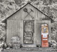 Filling Station (magnetic_red) Tags: shack metal rusted rust barrel wood pump gas station filling door shovel pick abandoned popofcolor nevada americanwest