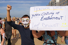 Century of enslavement (Red Cathedral is offroad + off-grid in les Pyrn) Tags: sonyalpha a77markii a77 mkii eventcoverage alpha sony colorrun sonyslta77ii slt evf translucentmirrortechnology redcathedral belgium alittlebitofcommonsenseisagoodthing activism protest oostednde oostende ostend anonymous mask guyfawkes revolution demonstration maskedface millionmaskmarch mmm2016