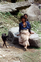 11-471 (ndpa / s. lundeen, archivist) Tags: nepal people woman dog color film animal 35mm asian clothing women asia southeastasia sitting candid nick 11 clothes barefoot nepalese 1970s 1972 seated villagers nepali southasia dewolf nickdewolf photographbynickdewolf reel11 mountaindwellers