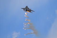 F-15E Dropping flares (JetImagesOnline) Tags: fighter jet airshow boeing airforce burner usaf flares nellis afterburner f15e strikeeagle aviationnation
