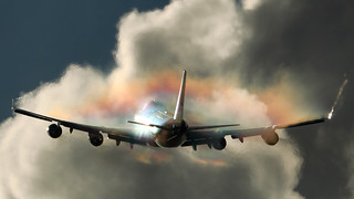 PH-BFK KLM 747 creating a rainbow-condensation-cloud after take off from EHAM Schiphol