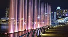 Experience Southeast Asia's largest light and water show... (williamcho) Tags: christmas xmas cityscape esplanade promenade boardwalk hotels afterdark attractions 2012 louisvuitton sunteccity mandarinoriental musicalfountain marinabay swissotelthestamford visualeffects marinabaysands flickraward earthasia ledlightings topazlabadjust flickrtravelaward surroundsounds williamcho largestlightwatershow