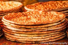 Xinjiang Naan Bread (Feng Wei Photography) Tags: china food color beautiful horizontal closeup bread yummy asia chinesefood chinese tasty fresh delicious xinjiang bazaar oriental freshness naan flatbread selectivefocus kucha kuche kuqa staplefood