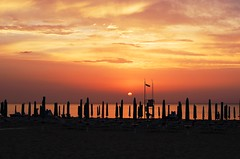 remembering sunset on the beach (SS) Tags: light sunset red sea summer vacation sky italy seascape black beach water colors weather yellow backlight clouds composition contrast photography golden evening mare mood pattern glow shadows dof vie