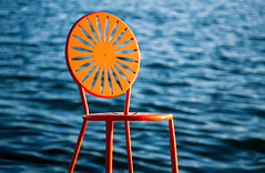 Fancy Chair (Todd Klassy) Tags: city travel school sea orange sun lake college tourism uw water wisconsin campus fun boats outdoors student chair education memorial colorful university waves pattern terrace seat horizon union shoreline bluesky visit patio deck entertainment madison shore badgers boating sail uwmadison sunburst dining ripples recreation bigten copyspace watersports mendota universityofwisconsin wi backtoschool lakefront starburst clearsky annex madisonwisconsin memorialunion waterscape lakemendota selectivefocus theunion stockphotography buckybadger big10 urbanscene memorialunionterrace hoofers outdoorspace collegeunion bodyofwater sunburstchair madisonphotographer cityofmadison toddklassy madisondocumentaryphotographer