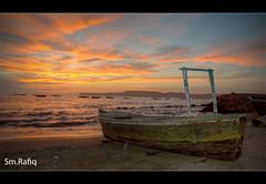 GAWADAR FISH HARBOR (S.M.Rafiq) Tags: pakistan sunset red sea sky sun beach wet clouds sunrise boats dawn boat sand asia waves soil shore gwadar balochistan gawadar fishharbor smrafiq  gawadarharbor gawadarfishharbor