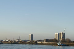 View across the river from Woolwich (will668) Tags: pictures camera uk greatbritain blue light chimney england sky london tower water ferry thames buildings river lens boats photography pier boat photo aperture focus exposure flickr industrial factory dof image photos unitedkingdom crane smoke tide towers picture bluesky pic depthoffield cranes flats jetstream imaging bouy riverthames towerblock photosharing towerblocks thamesbarrier sunnyskies woolwichferry woolwicharsenal tateandlyle boatcrane williamconnolly will668