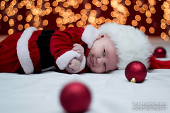 Holiday Mini (AgentThirteen) Tags: santa christmas red baby white holiday lights infant bokeh ornaments