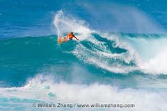 At the crest of a wave at Ehukai Beach Park on North Shore of O'ahu, Hawai'i (williamzhang.com) Tags: travel sky usa tourism beach clouds island hawaii polynesia sand surf waves unitedstates oahu surfer scenic aquamarine surfing pacificocean surfboard coastline ehukaibeachpark