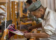 weaving Atalas pattern with silk on the loom (Eric Lafforgue) Tags: china travel people man industry tourism horizontal beard person photography concentration clothing day muslim traditional working chinese craft oldman indoor textile hotan uighur xinjiang silkroad worker daytime inside uyghur weaver cloth minority weaving 2people twopeople weave anthropology loom beardedman silkfactory ethnicity sociology peoplesrepublicofchina autonomy dayview turkic seniorman humanright uygur ouigour twopersons colorpicture adultonly colourimage doppi ethnicgroup xinjiangprovince colourpicture xinjianguyghurautonomousregion traditionallychinese easternandcentralasia turkicethnicgroup uygurethnicity atalaspattern doppilar eti0726