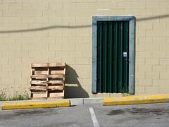 Pallet & Door (Drew Makepeace) Tags: pallet door parking wall