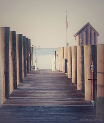 If Norman Rockwell lived here... (megmcabee) Tags: usa flag bay pier dock texture