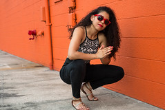 Mandy (Gabriel_Rodriguez) Tags: actress actor model photoshoot photography sidewalks bless smile blackpants curlyhair red sunglasses pose wall orange