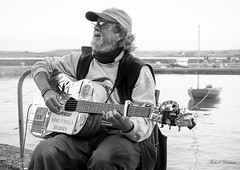 1 (Oggy Dawson) Tags: bw streetphotography padstow busker cornwall