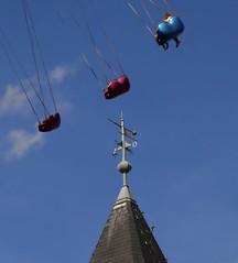 Sky high (Duevel) Tags: zweefmolen kerktoren lucht sky kermis torenhoog goingwest wolken clouds churchtower carousel roundabout merrygoround