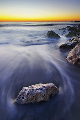 Re-entry (night86mare) Tags: light sunset sea usa motion beach rock america sand key energy pastel wave k5 clearwater 10mm