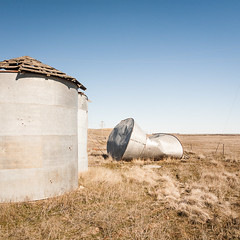 Giant's Popcan (Chicken®) Tags: blue usa brown 3 abandoned rural silver giant square three washington unitedstates farming silo agriculture toppled squashed ritzville disrepair palouse popcan teske