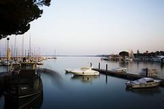 Desenzano1 (cioligiovanni) Tags: canon lago eos nikon garda italia pentax barche nave porto cielo di inverno brescia tempo desenzano hoya gardalake gardasee chiatta lungo 110
