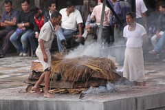 Pashupatinah scenes - starting the pyre (10b travelling) Tags: charity nepal river temple fire earthquake asia funeral disaster kathmandu himalaya himalayas pyre templo himalayan tempel 2010 cremation catastrophe nepali ghat southasia pye pashupatinah carstentenbrink
