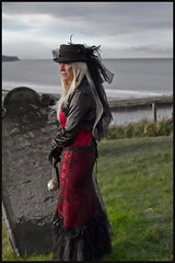 7D0039a Lady in Red Dress with Black Hat & Blouse 1 - Whitby Goth Weekend 3rd Nov 2012 (gemini2546) Tags: nov red goth over blond week 3rd long black 2470 canon sigma lady dress hair face 7d lens church yard hat skirt blouse lace jewels whitby 2012 victorian graves lacedup feathers gloves