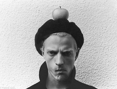 Hans 1986 (P H Lyen) Tags: portrait blackandwhite bw man art apple monochrome face hat wall fruit weird nikon artist arty serious sweden stockholm expression portait coat pale dude odd angry stare sly sour beret simple stern fm2 calculating