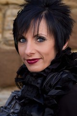 7D0080a Beautiful Lady with Black satin top & Black Hair - Whitby Goth Weekend 3rd Nov 2012 (gemini2546) Tags: nov goth week satin 3rd black 2470 blue canon sigma hair eyes beautiful 7d lens top lady whitby 2012 neckline ruffled