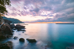 Sunset In Shower (-TommyTsutsui- [nextBlessing]) Tags: longexposure blue winter light sunset sea sky orange seascape nature yellow rock japan clouds landscape nikon purple dusk jetty magic tide scenic       izu 410  matsuzaki sigma1020  onsalegettyimages