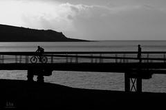 Sunset promenade (G.Eco) Tags: sunset shadow sea blackandwhite sun mer water bicycle silhouette soleil noiretblanc coucher ombre saintpaul bicyclette réunion vélo débarcadère