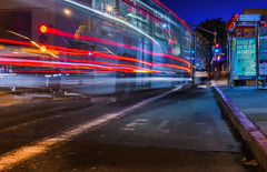 geary street muni bus stop (pbo31) Tags: sanfrancisco california nikon d810 color july 2016 summer boury pbo31 bayarea city urban lightstream motion night dark black muni bus stop gearystreet innerrichmonddistrict red traffic roadway transit public motionblur