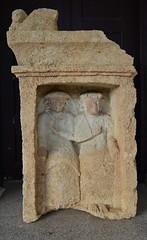 Egyptian couple, Cypriot stele (orientalizing) Tags: afterlife archaeologicalmuseum archaia cyprus easterncoast egyptianizing falsedoorstele funerarysculpture gravemarker limestone lions localmuseum northerncyprus sculpture stbarnabaschurch turkishoccupiedcyprus