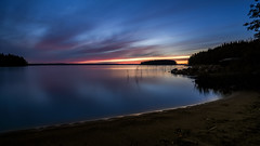 Calm (Superfantti) Tags: blue yellow lake water beach h2o rocks sand line between land clouds sunset star