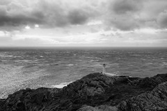 Holding up the fire (OR_U) Tags: 2016 oru uk wales anglesea ziggymarley southstack holyheadlighthouse lighthouse bw blackandwhite blackwhite schwarzweiss seascape sea ocean rocks coast clouds weather