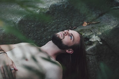 Born Again (Furcifer07) Tags: born again sylvia plath dead eyes open eye closed moss stone rockks rocks forest woods nature green grey male man model brunette portrait portraiture long hair canon 5d mark iii