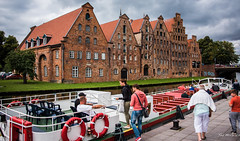 2016 - Baltic Cruise -  Lbeck Germany - Canal (Ted's photos - For Me & You) Tags: 2016 cropped germany lubeck tedmcgrath tedsphotos vignetting canal canalscene brick brickbuildings streetscene street people peopleandpaths salzspeicher salzspeicherlbeck saltstorehouses saltstorehouseslbeck transportation bollard seating seats barge canalbarge barbarosa backpack unesco unescoworldheritagesite trave traveriver traveriverlubeck