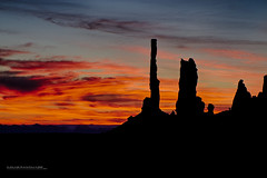 Totums Against a Sky of Fire (Howard Brown Photographic) Tags: utah poles monumentvalley hdr totum totumpoles