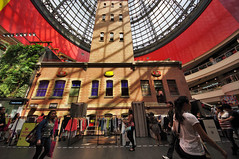Melbourne Central (Jumpin'Jack) Tags: red people building brick tower glass vertical wall mall shopping garden walking lens high shot cone magic centre central sigma australia melbourne wideangle victoria covered huge tall 8mm ultra hdr shoppers coops rectilinear infrontof witha insidethe