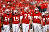 Front Line (www.toddklassy.com) Tags: red people white game men uw sports students horizontal wisconsin standing season outdoors football team athletics emotion cardinal action unity battle iowa gameday madison numbers badgers angry stockphotos editorial strength uniforms jerseys players fullframe adidas ncaa amateur universityofwisconsin groupofpeople wi defense huddle helmets teamwork collegefootball stockphotography offense buckybadger big10 royaltyfree colorimage shouldertoshoulder camprandallstadium bigtenconference division1a wisconsinphotography faceguards wisconsinphotographers toddklassy universityofwisconsin–madison athleticprogram