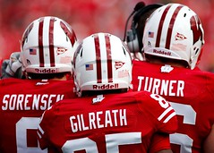 Wisconsin Players (www.toddklassy.com) Tags: red people white game men uw sports students horizontal wisconsin standing season outdoors football team athletics emotion cardinal action unity battle iowa gameday madison numbers badgers angry stockphotos editorial strength uniforms jerseys players fullframe adidas ncaa amateur universityofwisconsin groupofpeople wi defense huddle helmets teamwork collegefootball stockphotography offense buckybadger big10 royaltyfree colorimage shouldertoshoulder camprandallstadium bigtenconference division1a wisconsinphotography faceguards wisconsinphotographers toddklassy universityofwisconsinmadison athleticprogram